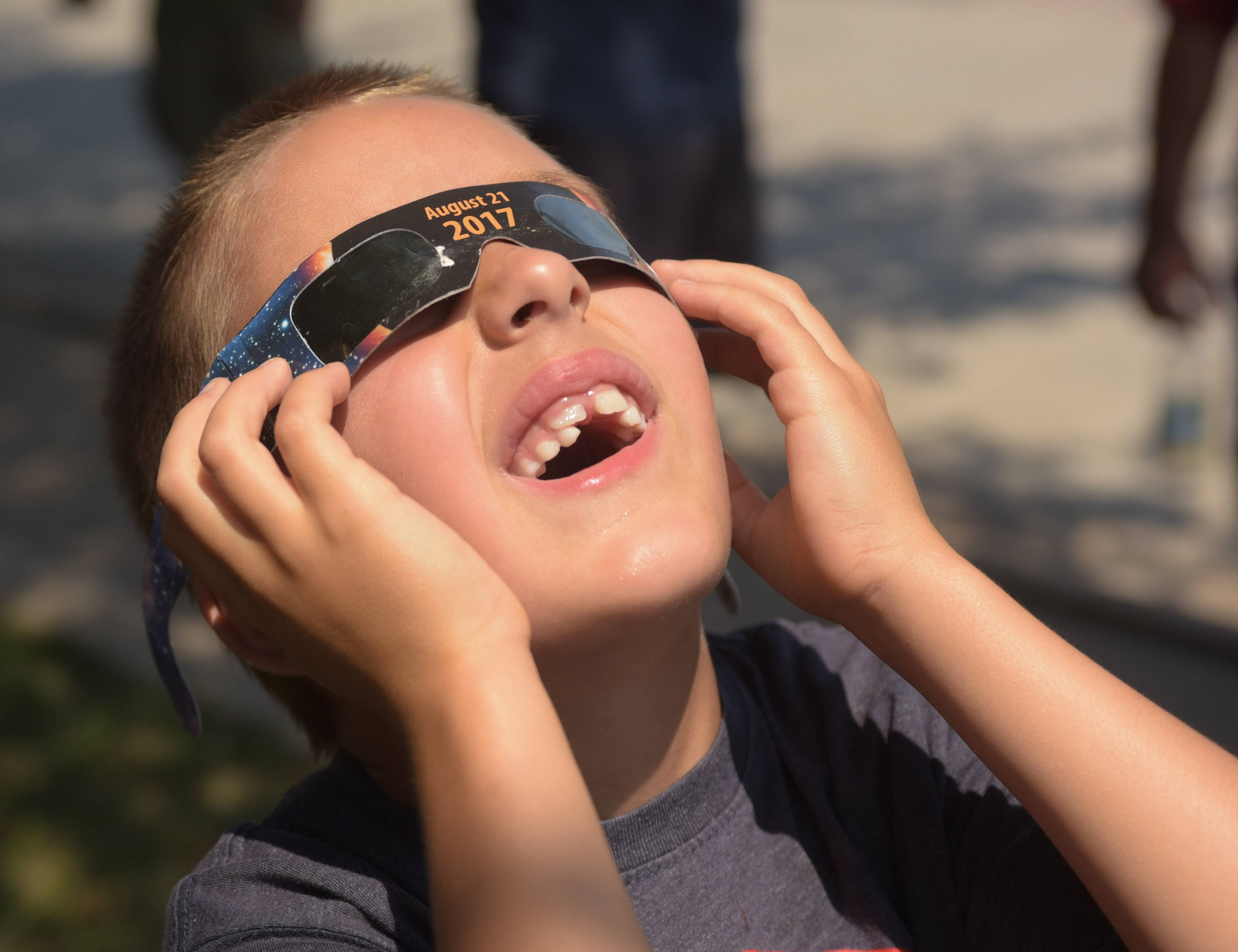 Nathan Stepansky, 6 of Orland Park views the eclipse in Chester.