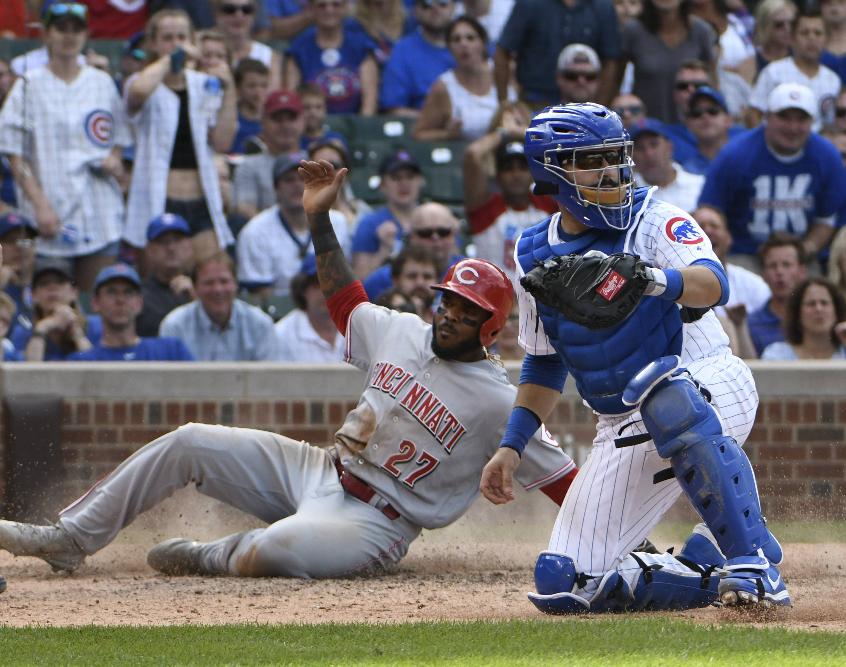 Cincinnati Red's Phillip Ervin (27) is safe at home as Chicago Cubs catcher Alex Avila (13) waits for the throw during the ninth inning of a baseball game, Thursday, Aug. 17, 2017, in Chicago. (AP Photo/David Banks)
