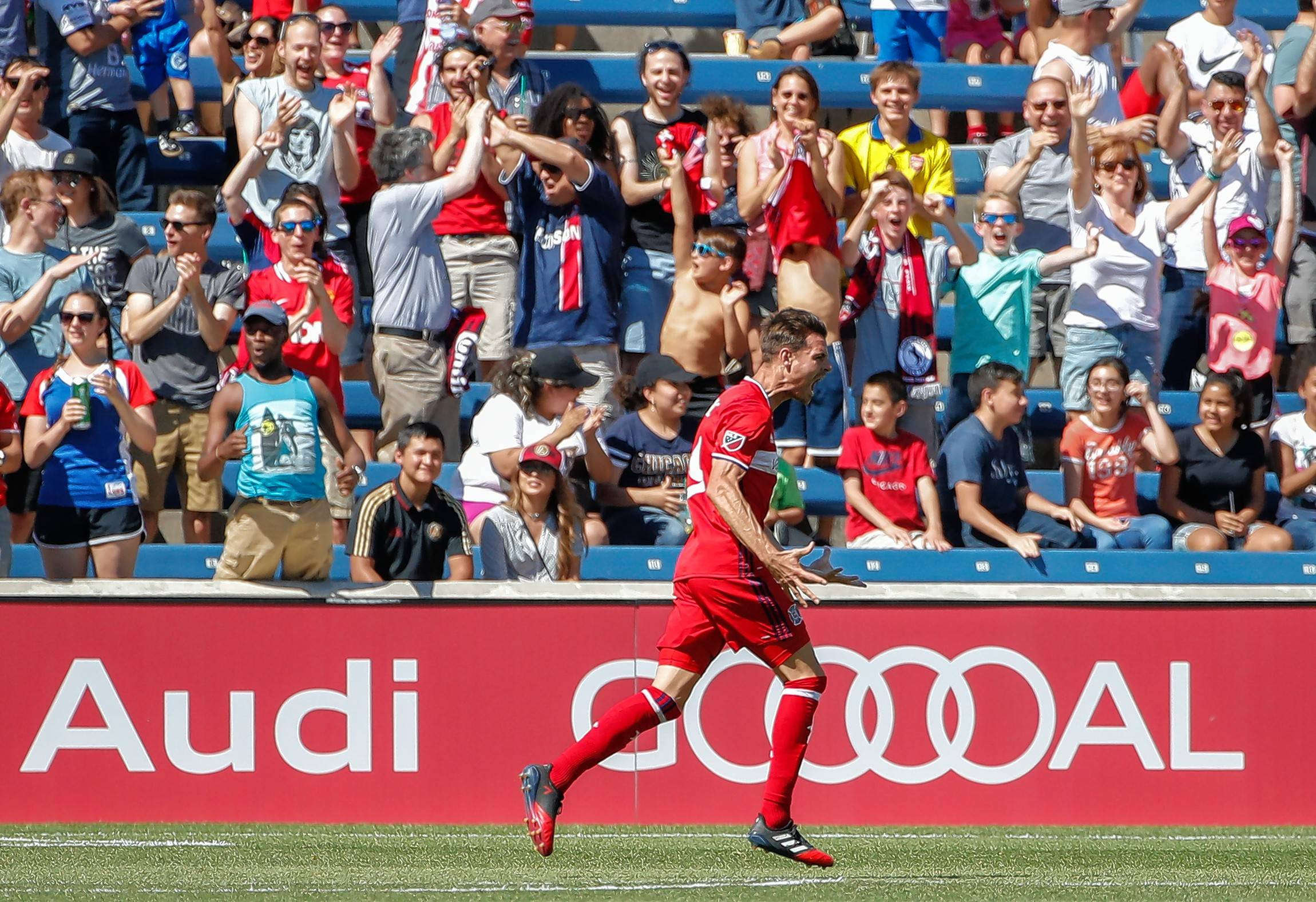 Chicago Fire fans do more than celebrate a goal for their team, in this case one by forward Luis Solignac. Many of them will join together in October for a 20th anniversary celebration to honor their club.