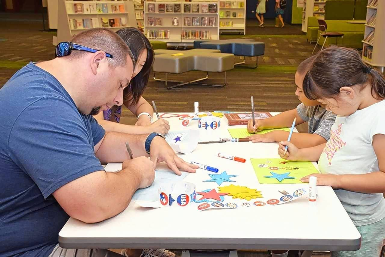 "A family expresses their gratitude for the U.S. military during the ""Letters to Soldiers"" program held earlier this month in the Schaumburg Library's Workshop."