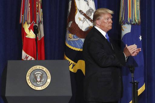 President Donald Trump applauds as he walks off the dais after speaking at Fort Myer in Arlington Va., Monday, Aug. 21, 2017, during a Presidential Address to the Nation about a strategy he believes will best position the U.S. to eventually declare victory in Afghanistan. (AP Photo/Carolyn Kaster)