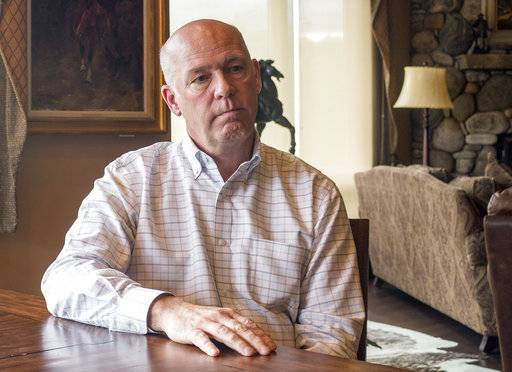 FILE - In this June 20, 2017 file photo, Rep.-elect Greg Gianforte responds to questions at his home in Bozeman, Mont., about an election-eve confrontation with a reporter. A judge has ordered Gianforte to be photographed and fingerprinted for assaulting a reporter, opening the possibility of the congressman's mug shot to be used by political opponents next year when Gianforte is up for re-election. (AP Photo/Bobby Caina Calvan, File)