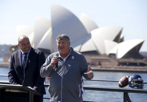 U.S. college football head coach from Rice David Bailiff, right, comments during the launch of the season opening NCAA football game in Sydney, Tuesday Aug. 22, 2017. The game will be played on Sunday. (AP Photo/Rick Rycroft)
