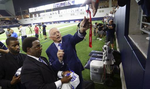 Dallas Cowboys owner Jerry Jones signs autographs for fans before the start of an NFL training camp football practice at the team's headquarters in Frisco, Texas, Monday, Aug. 21, 2017. (AP Photo/LM Otero)