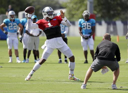 File-This Aug. 17, 2017, file photo shows Carolina Panthers quarterback Cam Newton passing during a combined NFL football training camp with the Tennessee Titans in Nashville, Tenn. Panthers coach Ron Rivera is chomping at the bit to get his full contingent of offensive players on the football field. That might just happen this week. Newton and wide receiver Curtis Samuel, the team's rookie second-round draft pick, are on pace to play Thursday night against the Jacksonville Jaguars after missing the first two preseason games rehabbing from injuries. (AP Photo/Mark Humphrey, File)