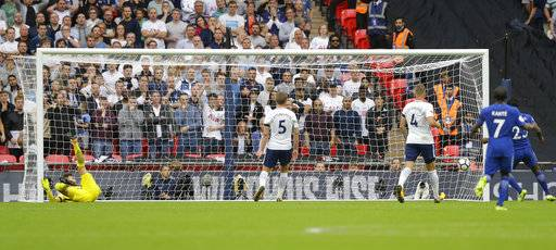 Tottenham Hotspur's goalkeeper Hugo Lloris, left, lies on the ground and looks round as Chelsea's Marcos Alonso shot goes past him for the winning goal during their English Premier League soccer match between Tottenham Hotspur and Chelsea at Wembley stadium in London, Sunday, Aug. 20, 2017. Chelsea won the match 2-1. (AP Photo/Alastair Grant)