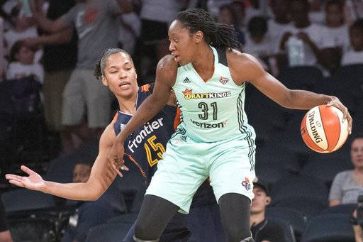 "File-This July 19, 2017, file photo shows New York Liberty center Tina Charles (31) driving to the basket against Connecticut Sun forward Alyssa Thomas (25) during the first half of a WNBA basketball game, at Madison Square Garden in New York. Charles and her New York Liberty teammates have never shied away from speaking out against social injustices. The Liberty players, along with many others across the WNBA, were vocal last summer in support of the black lives matters movement. On Sunday, Aug. 20. 2017, the Liberty hosted the first ""Unity Game"" in the WNBA with the Minnesota Lynx. The two teams as well as members of the NYPD and Covenant House locked arms during the playing of the national anthem. (AP Photo/Mary Altaffer, File)"