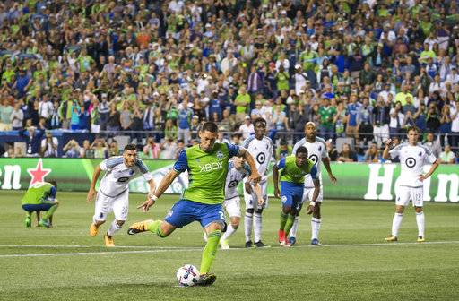 Seattle Sounders midfielder Clint Dempsey scores on a penalty kick in stoppage time to lift Seattle to a 2-1 win over Minnesota United during an MLS soccer match Sunday, Aug. 20, 2017, in Seattle. (Bettina Hansen/The Seattle Times via AP)