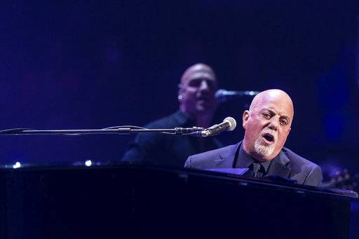 FILE - In this Nov. 21, 2016, file photo, Billy Joel performs at Madison Square Garden in New York. Joel performed at the arena on Aug. 21, 2017, with a yellow Star of David sewn to his sport coat. (Photo by Michael Zorn/Invision/AP, File)