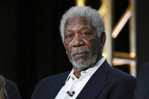 "FILE - In this Jan. 6, 2016, file photo, actor Morgan Freeman participates in the ""The Story of God"" panel at the National Geographic Channel 2016 Winter TCA in Pasadena, Calif. Freeman will receive the SAG Life Achievement Award at next year's Screen Actors Guild Awards ceremony. The actors union announced Tuesday, Aug. 22, 2017, that Freeman will accept its highest honor on Jan. 21, 2018. (Photo by Richard Shotwell/Invision/AP, File)"