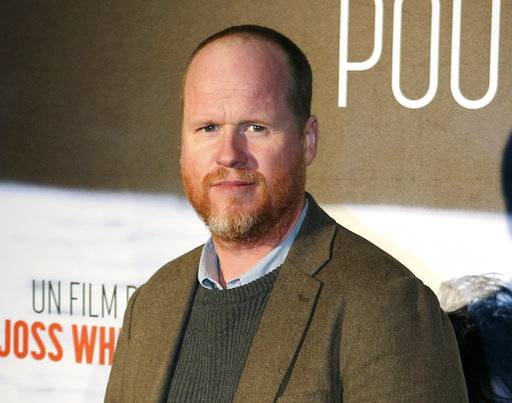 "FILE - This Jan. 21, 2014, file photo shows American film producer and director Joss Whedon at the screening of ""Much Ado About Nothing"" in Paris. Whedon's ex-wife Kai Cole alleged in an essay published by The Wrap on Aug. 20, 2017, that Whedon had multiple affairs during their 16-year marriage. (AP Photo/Remy de la Mauviniere, File)"