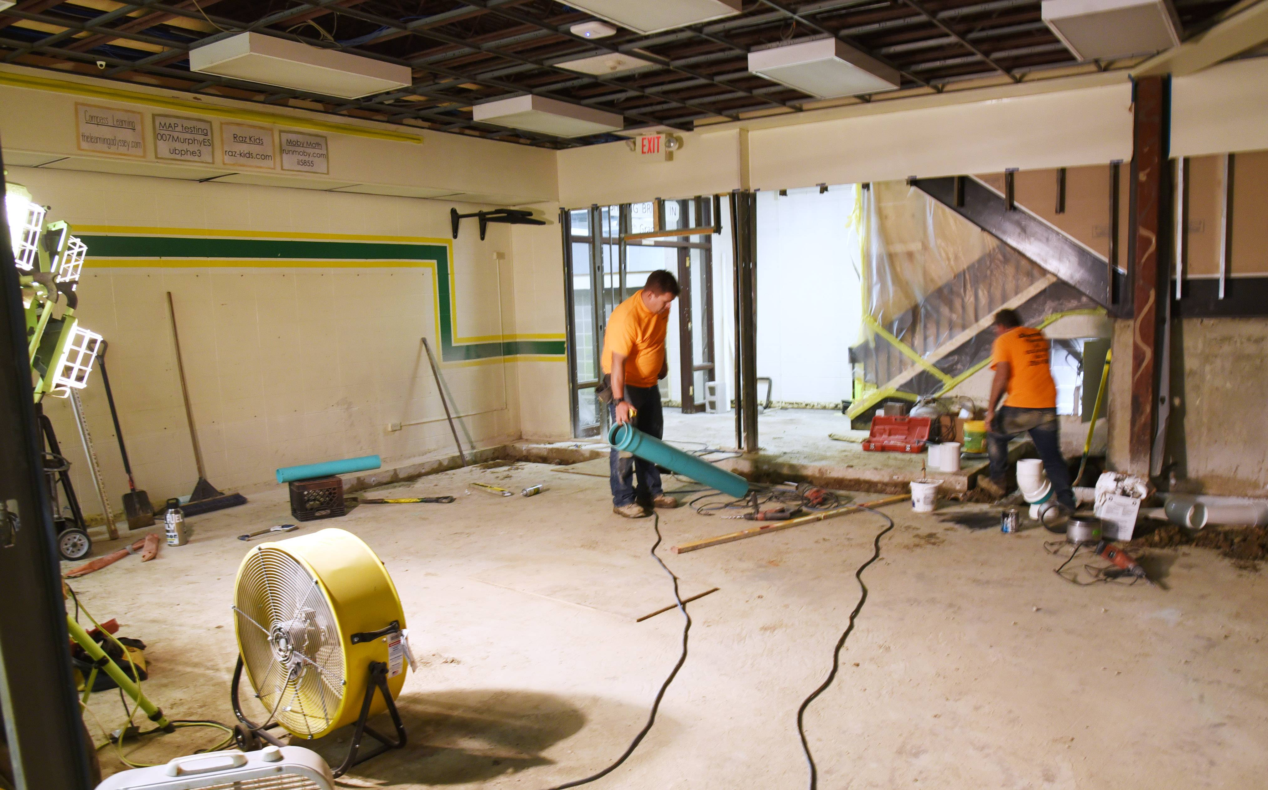 "Crews are hard at work to turn the former library and computer lab at Murphy Elementary School in Round Lake Park into a modern learning space dubbed a ""Limitless Learning Common."""