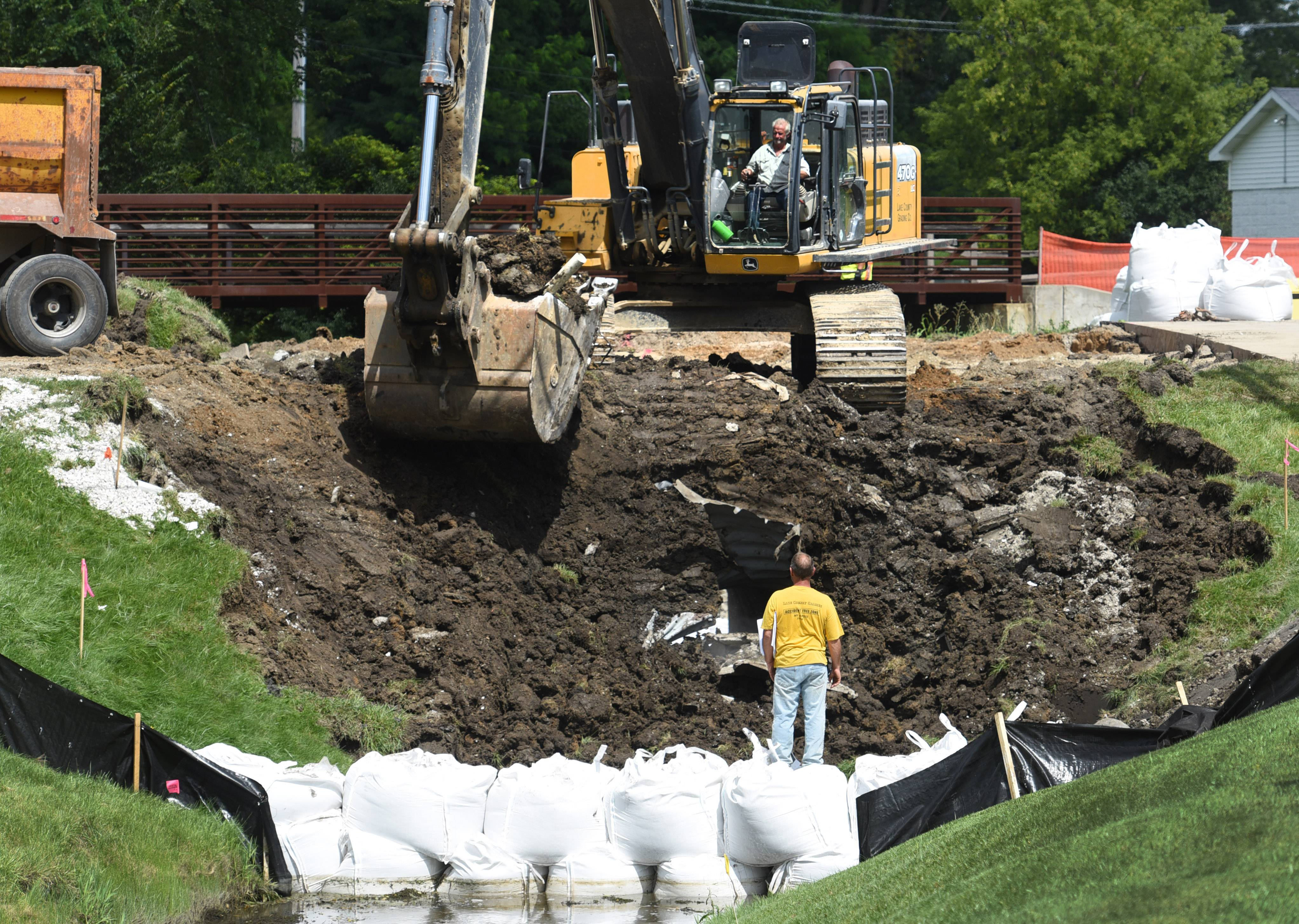 Crews have begun work to replace a large culvert under Center Street in Grayslake that collapsed as a result of flash flooding last month. The street is scheduled to reopen Sept. 1.