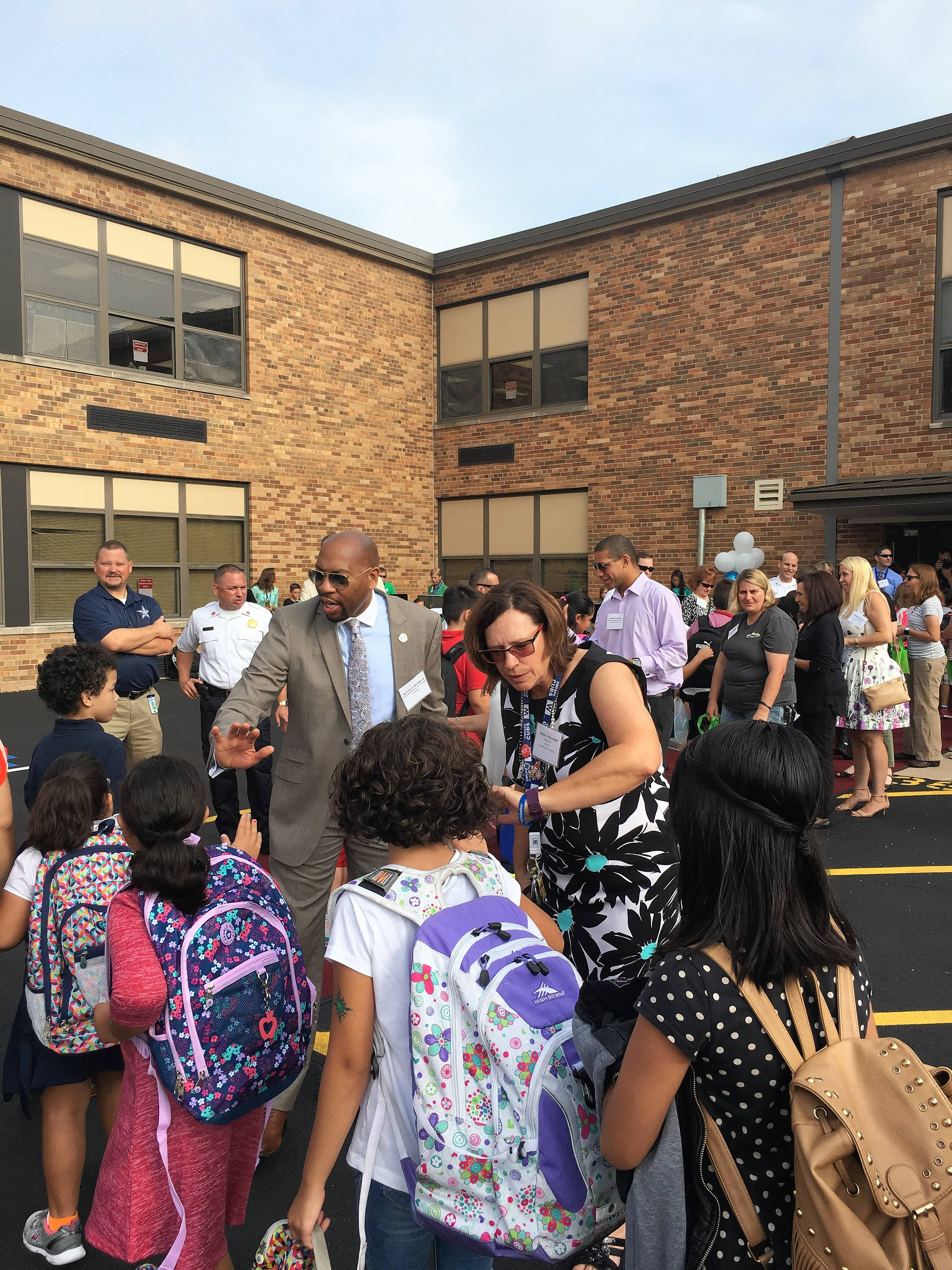 District 62 Superintendent Floyd Williams and North Elementary School Principal Denise Fernandez greet students entering school on their first day.