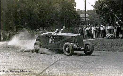 A car races past spectators at the 1933 Elgin National Road Race.