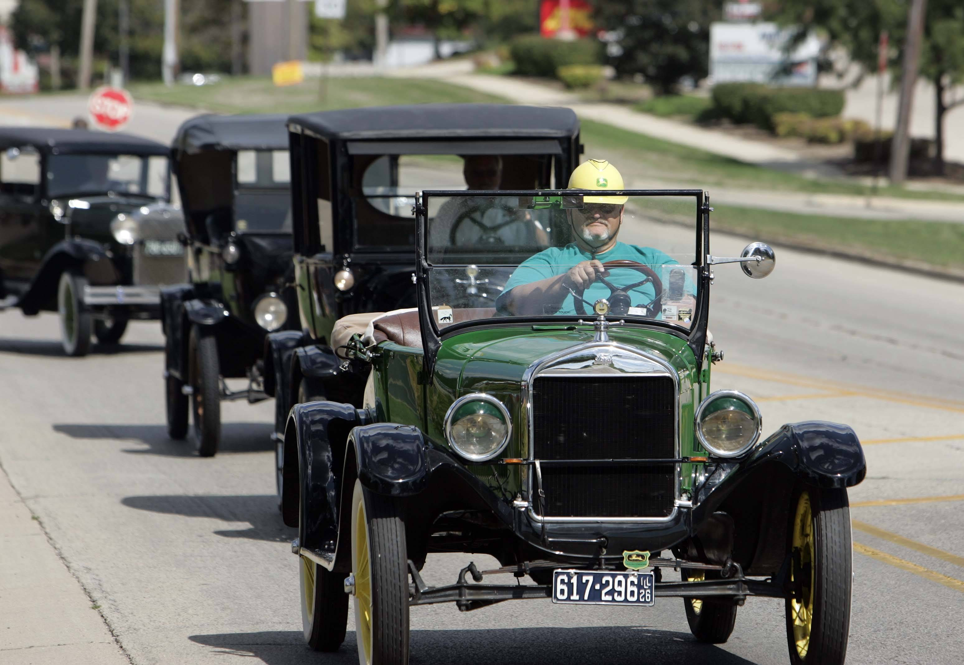 Maurice Dyer of Elgin leads the way in his 1926 Model T Roadster as the Elgin Road Race and Car Show leaves Sherman West Court on Larkin Avenue in Elgin for its tour of the original race route.