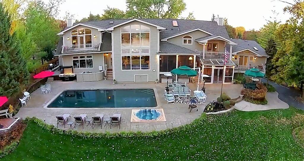 Two prominent business executives will have a coin flip to decide who prevails in a $25,000 difference in price for this Barrington-area house on the Fox River while raising funds for charitable efforts run by sheriff's offices in Lake and McHenry counties. The fun gathering is set for 6 p.m. Sunday at No Wake Bar and Grill, 99 Kazimour Drive in Port Barrington. August 2017.