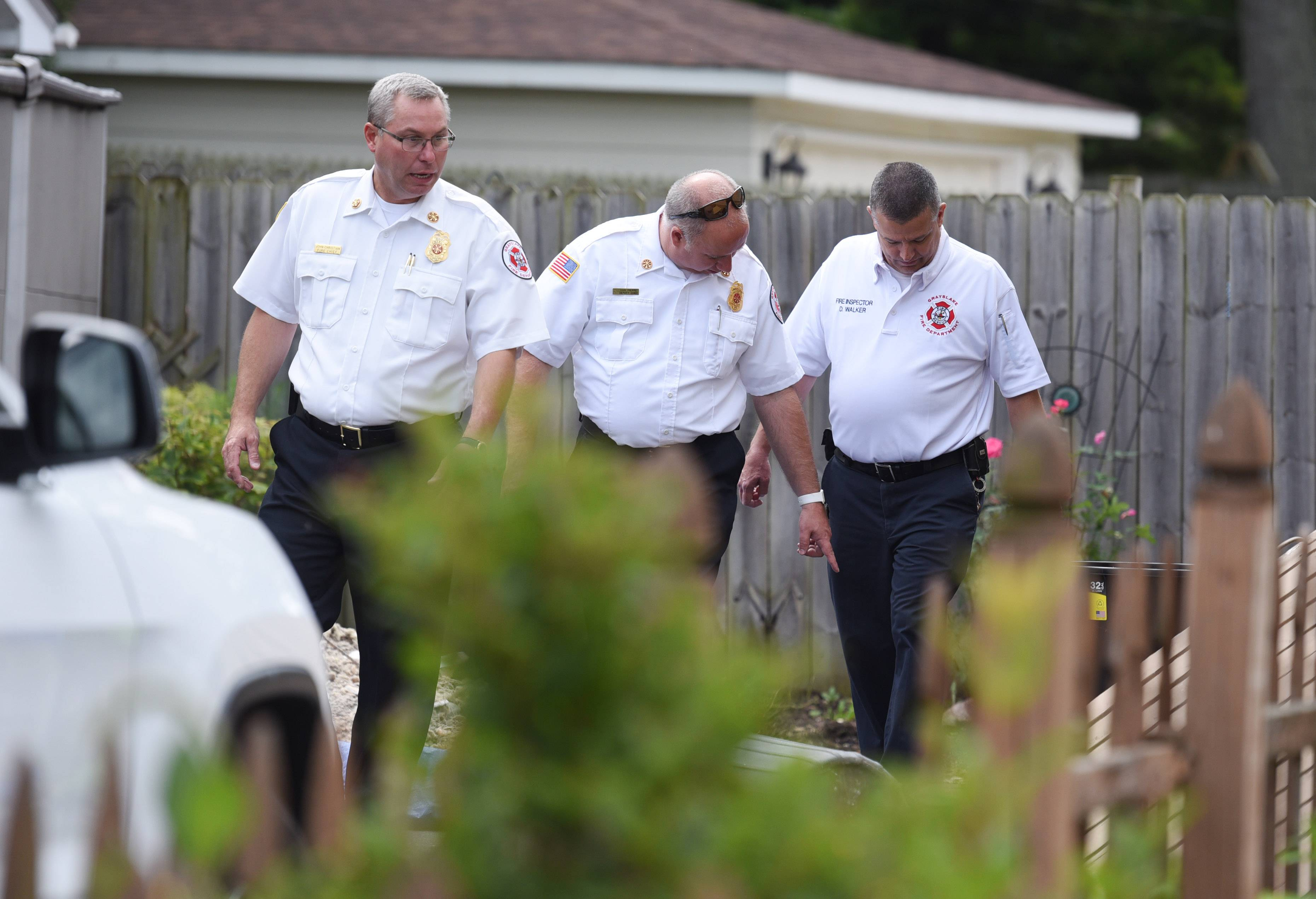 Grayslake Fire Chief John Christian, from left, Deputy Chief Dan Pierre and Fire Inspector Dean Walker at the fire scene Tuesday morning on the 300 block of Normandy Lane in Grayslake.