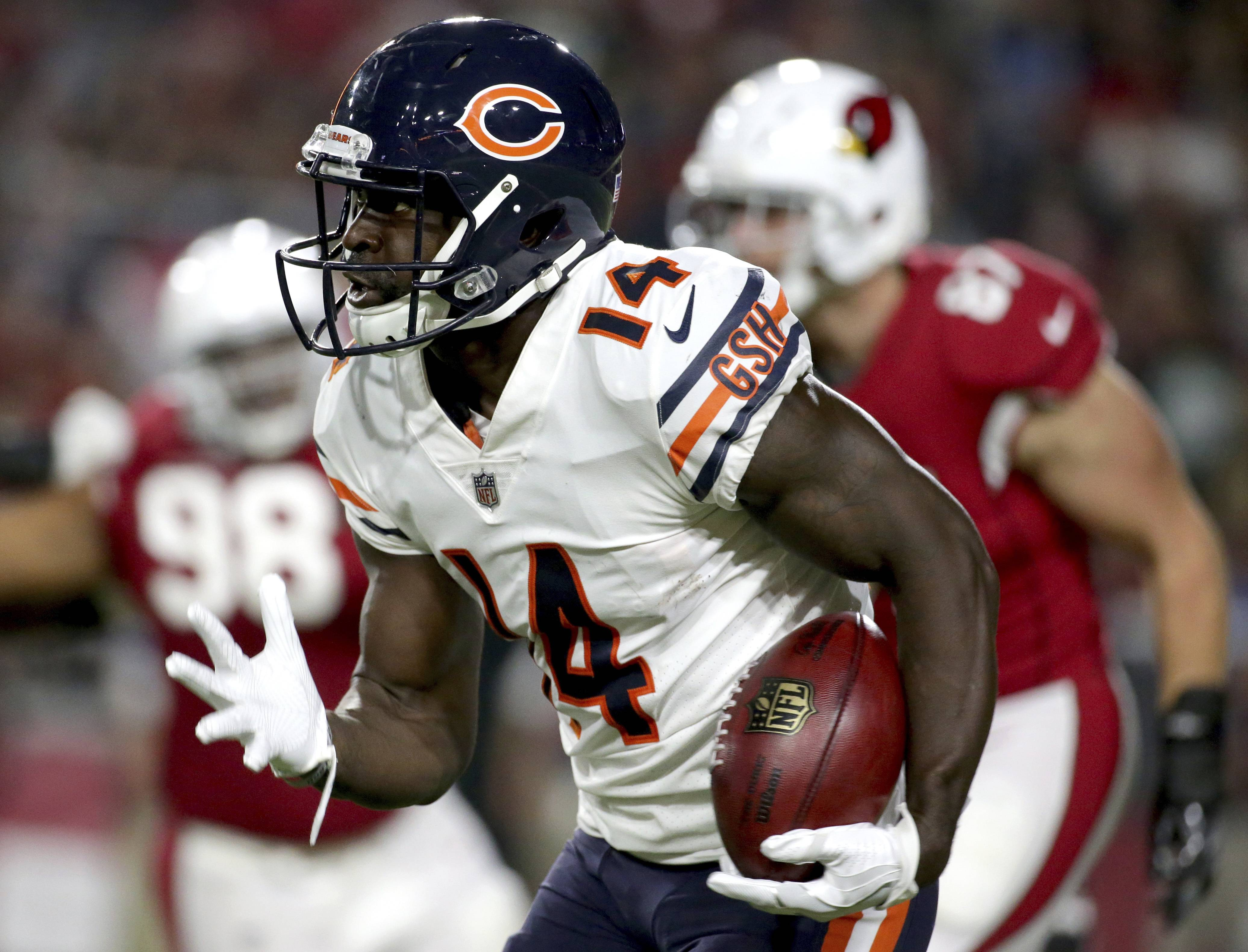 Chicago Bears wide receiver Deonte Thompson (14) runs back a missed field goal attempt for a touchdown against the Arizona Cardinals during the first half of a preseason NFL football game, Saturday, Aug. 19, 2017, in Glendale, Ariz. (AP Photo/Ralph Freso)