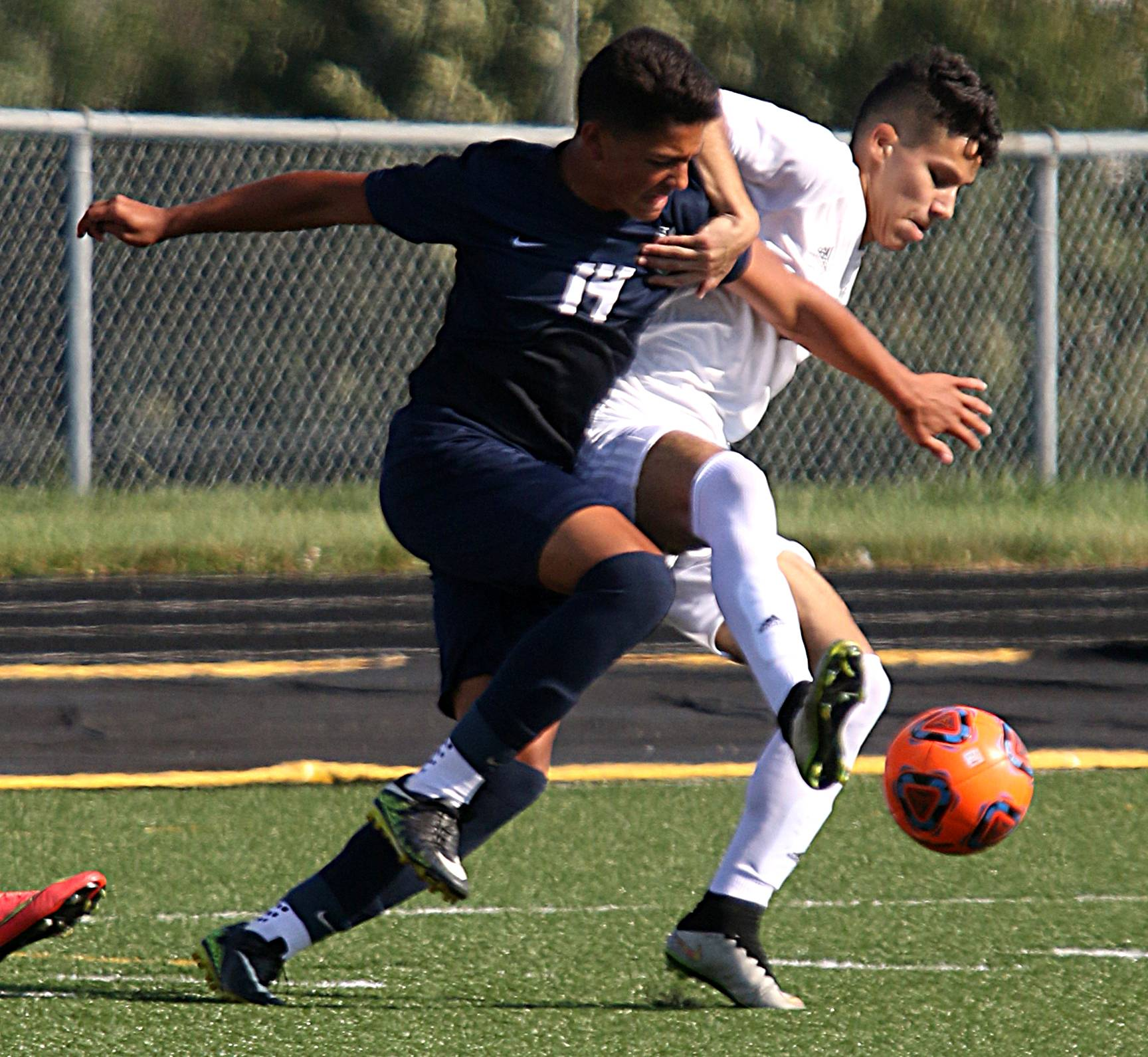 Streamwood's Oscar Chavez, right, races Bartlett's Nicolas Gomez to the ball during soccer action at Millennium Field on the campus of Streamwood High School Tuesday evening.