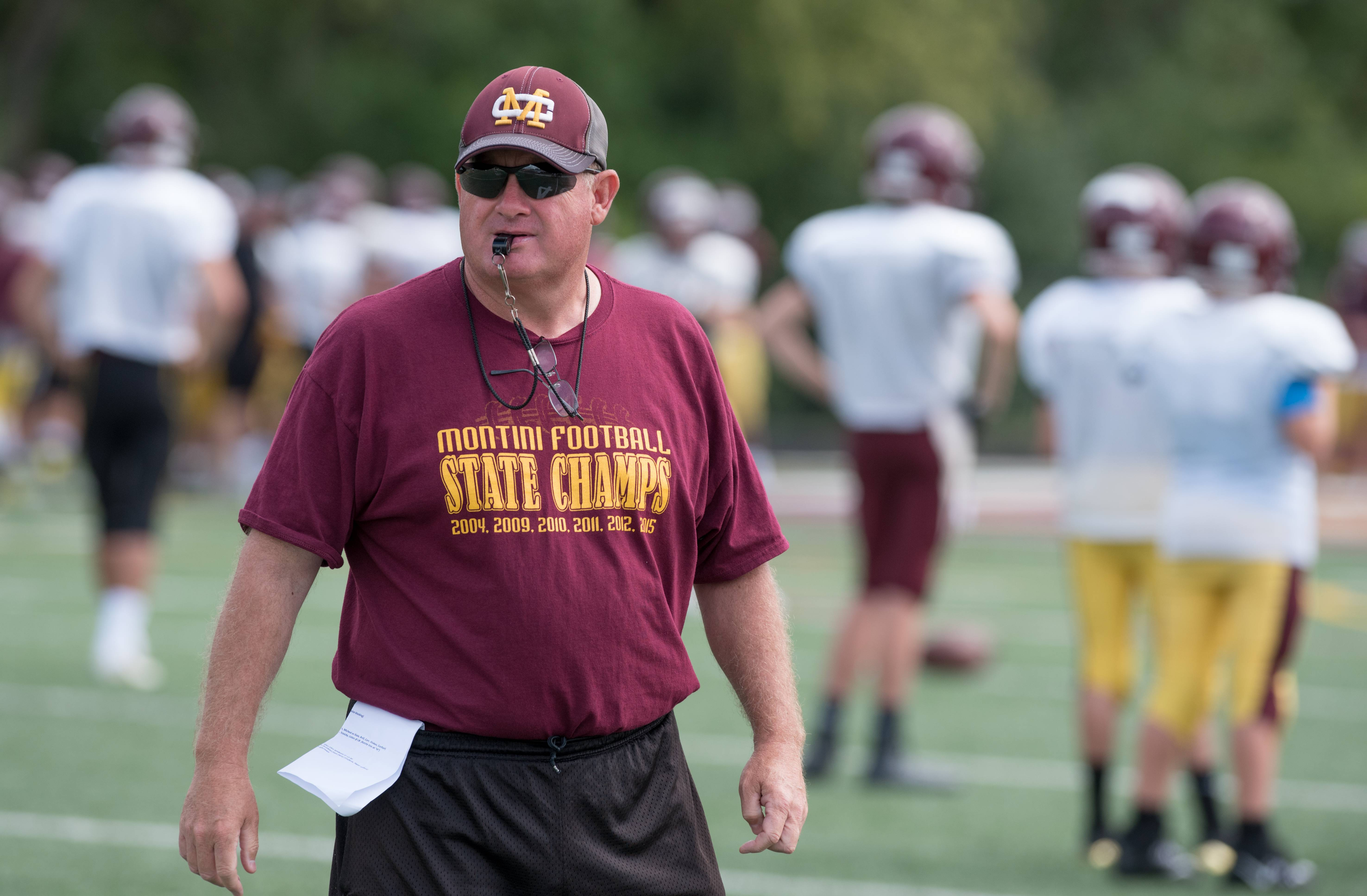 Montini varsity football head coach Mike Bukovsky during practice on August 12, 2017.