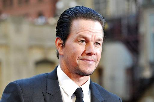 "FILE - In this Tuesday, June 20, 2017 file photo,Mark Wahlberg attends the U.S. premiere of ""Transformers: The Last Knight"" at the Civic Opera House on in Chicago. Wahlberg outmuscled Dwayne Johnson to become Hollywood's highest-paid actor in the past year with a transforming income of $68 million, according to Forbes magazine. The former rapper and underwear model known as Marky Mark beat out ""Baywatch� star Johnson with $65 million and The Rock's ""The Fate of the Furious� co-star Vin Diesel worth $54.5 million(Photo by Rob Grabowski/Invision/AP)"