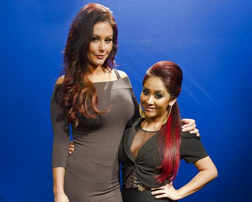"FILE - This Feb. 1, 2012, file photo shows Jenni ""Jwoww"" Farley, left, and Nicole ""Snooki"" Polizzi in New York. VH1 announced on Aug. 22, 2017, that the pair would be teaming up with Drita D'Avanzo of VH-1's ""Mob Wives� for a ""Jersey Shore"" spinoff called ""Celebrity Shore,� which will also air on VH1. (AP Photo/Charles Sykes, File)"