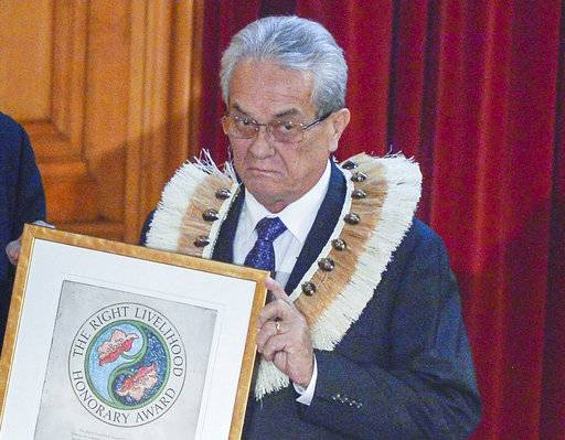 FILE - In this Nov. 2015 photo, Tony de Brum, Foreign Minister of the Marshall Islands, receives, on behalf of the people of the Marshall Islands an honorary award for their struggle against all nine nuclear weapons states for their failure to abide by the provisions of the Nuclear Non-Proliferation Treaty from Jakob von Uexkull, the founder of the award. De Brum saw the effects of rising seas from his home in the Marshall Islands and became a leading advocate for the landmark Paris Agreement and an internationally recognized voice in the fight against global warming. De Brum died Tuesday, Aug. 22, 2017, in the capital Majuro surrounded by his family, according to Marshall Islands President Hilda Heine. He was 72.(Vilhelm Stokstad/TT via AP)