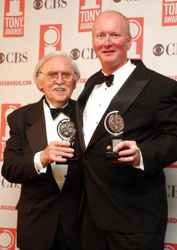 "FILE - In this June 8, 2003 file photo, Thomas Meehan, left, and Mark O'Donnell pose with their Tony awards for best book of a Musical for ""Hairspray"" during the 57th Annual Tony Awards at New York's Radio City Music Hall. On Tuesday, Aug. 22, 2017, Martin Charnin said that Meehan, the three-time Tony Award-winning book writer, has died. Meehan was 88. (AP Photo/Mary Altaffer, File)"