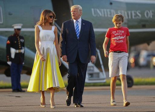FILE - In this Aug. 20, 2017 file photo, President Donald Trump, first lady Melania Trump and son Barron Trump walk across the tarmac before boarding Air Force One at Morristown Municipal Airport in Morristown, N.J., for the return flight to the Washington. The White House is appealing to the news media for privacy for President Donald Trump's young son, Barron. (AP Photo/Pablo Martinez Monsivais, File)