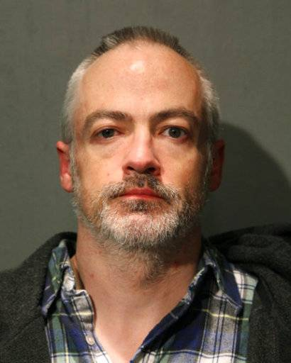 This booking photo provided by the Chicago Police Department shows Wyndham Lathem on Saturday, Aug. 19, 2017. Lathem, a Northwestern University professor, and Andrew Warren, an Oxford University financial officer, have been charged with first-degree murder in the death of Trenton James Cornell-Duranleau, a Michigan native who had been working in Chicago. Authorities say Cornell-Duranleau suffered more than 40 stab wounds to his upper body during the July attack in Lathem's high-rise Chicago condo. Lathem and Warren surrendered peacefully to police in California on Aug. 4 after an eight-day manhunt. (Chicago Police Department via AP)