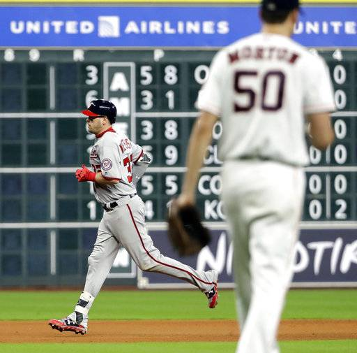 Washington Nationals' Matt Wieters (32) runs the bases after hitting a two-run home run off Houston Astros starting pitcher Charlie Morton (50) during the fourth inning of a baseball game Tuesday, Aug. 22, 2017, in Houston. (AP Photo/David J. Phillip)