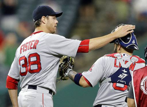 Boston Red Sox starting pitcher Doug Fister pats catcher Sandy Leon on the head after the Red Sox defeated the Cleveland Indians 9-1 in a baseball game, Tuesday, Aug. 22, 2017, in Cleveland. (AP Photo/Tony Dejak)