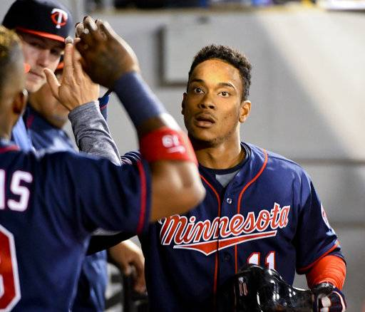 Minnesota Twins' Jorge Polanco (11) celebrates in the dugout after his home run against the Chicago White Sox during the fourth inning of a baseball game in Chicago on Tuesday, Aug. 22, 2017. (AP Photo/Matt Marton)