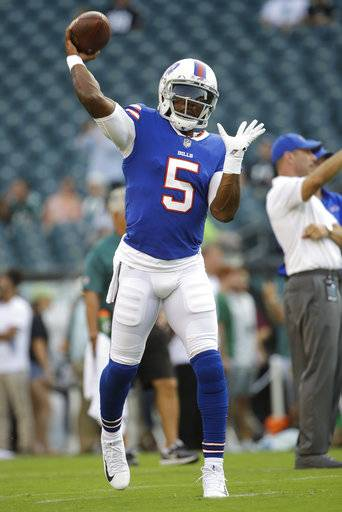 File-This Aug. 17, 2017, file photo shows Buffalo Bills quarterback Tyrod Taylor passing the ball before an NFL preseason football game against the Philadelphia Eagles in Philadelphia. Taylor understood there would be changes to the Buffalo Bills group of receivers when he elected to return for a third season by restructuring his contract in March. Little did he anticipate how drastic that transformation would become some four months later. (AP Photo/Matt Rourke, File)