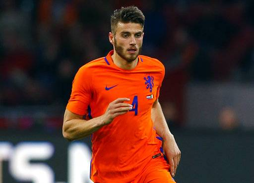 FILE - In this Thursday, March 30, 2017 file photo, Netherlands' Wesley Hoedt plays the ball during their international friendly soccer match against Italy at the Amsterdam ArenA stadium, Netherlands. Southampton has signed Wesley Hoedt from Lazio, it was announced on Tuesday, Aug. 22, and provided fresh evidence of its determination to retain his Netherlands teammate, Virgil van Dijk. Despite handing in a transfer request, van Dijk's attempts to leave the Premier League club have been rebuffed. (AP Photo/Peter Dejong)