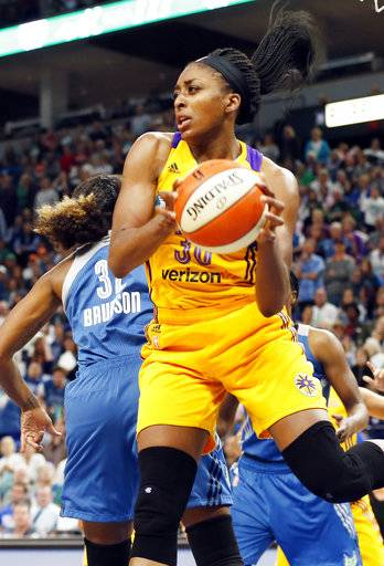File-This Oct. 11, 2016, file photo shows Los Angeles Sparks' Nneka Ogwumike pulling in a rebound next to Minnesota Lynx's Rebekkah Brunson during the first quarter of Game 2 of the WNBA Finals in Minneapolis. Without the two starters, the Lynx have dropped three of their last four games and fell out of first in The Associated Press WNBA power poll for the first time since week 2. Los Angeles took over the top spot Tuesday, Aug. 22, 2017. (AP Photo/Jim Mone, File)