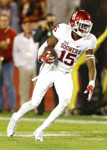 File- This Nov. 3, 2016, file photo shows Oklahoma wide receiver Jeffery Mead running up field after making a reception during the first half of an NCAA college football game against Iowa State in Ames, Iowa. For the second straight year, Oklahoma must replace a star receiver. And again, the Sooners feel they have the talent on the roster to get it done.(AP Photo/Charlie Neibergall, File)