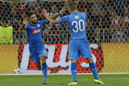 Napoli's Lorenzo Insigne, left, celebrates with teammate Rog after scoring during a Champions League playoff round, second leg soccer match between Nice and Napoli in Nice, France, Tuesday, Aug. 22, 2017. (AP Photo/Claude Paris)