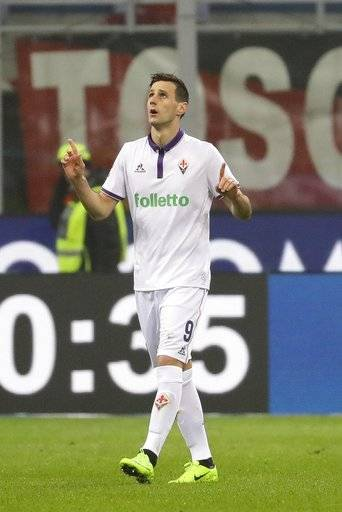 "FILE - In this Feb. 19, 2017 file photo Fiorentina's Nikola Kalinic celebrates after scoring during a Serie A soccer match between AC Milan and Fiorentina, at the San Siro stadium in Milan, Italy. In a brief statement on Tuesday, Aug. 22, 2017 AC Milan said it is ""delighted to announce the signing of Nikola Kalinic from Fiorentina ACF on a loan deal with obligation to buy."" (AP Photo/Antonio Calanni, file)"