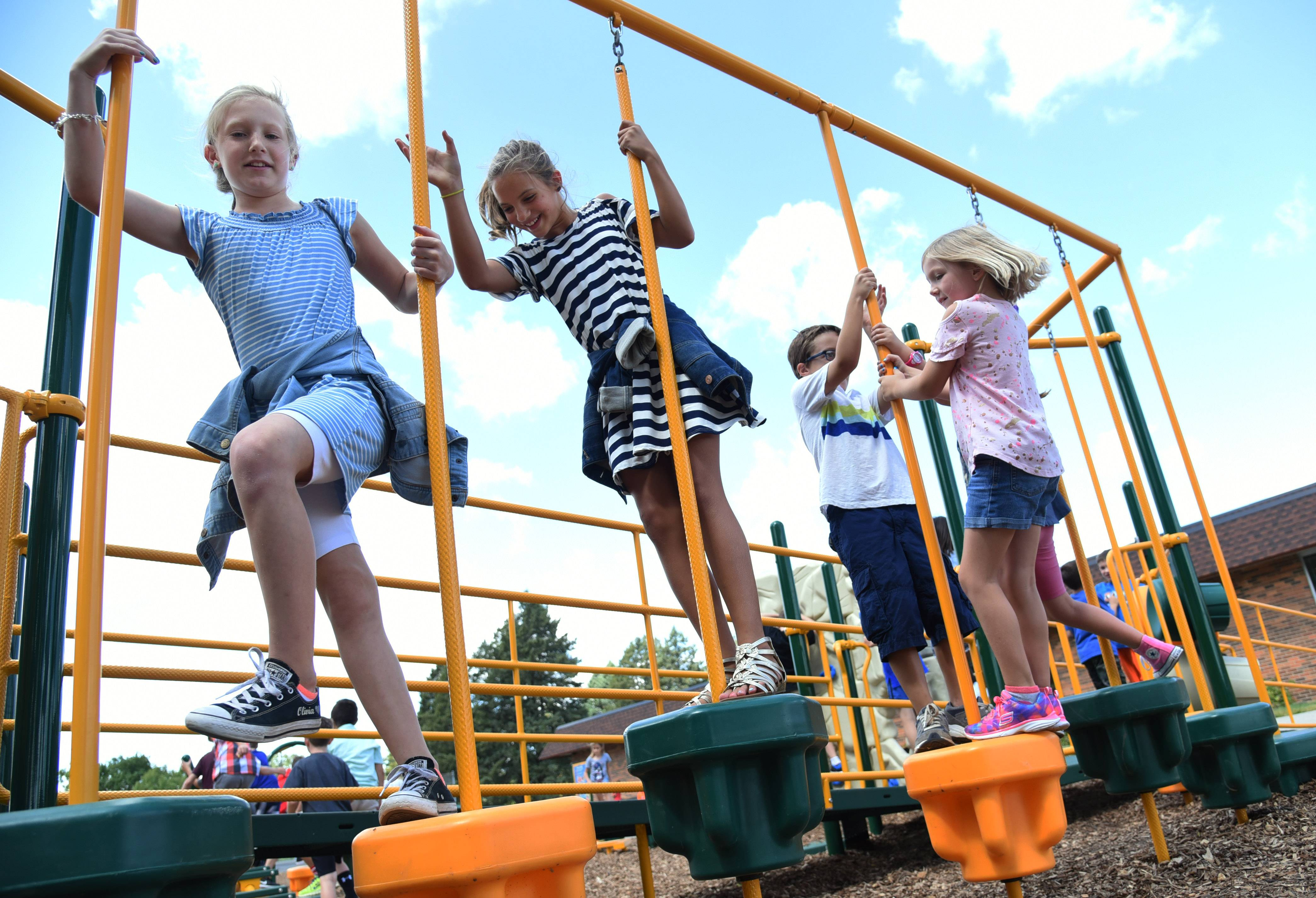 Butterfield School students enjoy a new playground during first day of classes Wednesday at the Libertyville school. Volunteers built the new ADA-compliant playground over the summer.