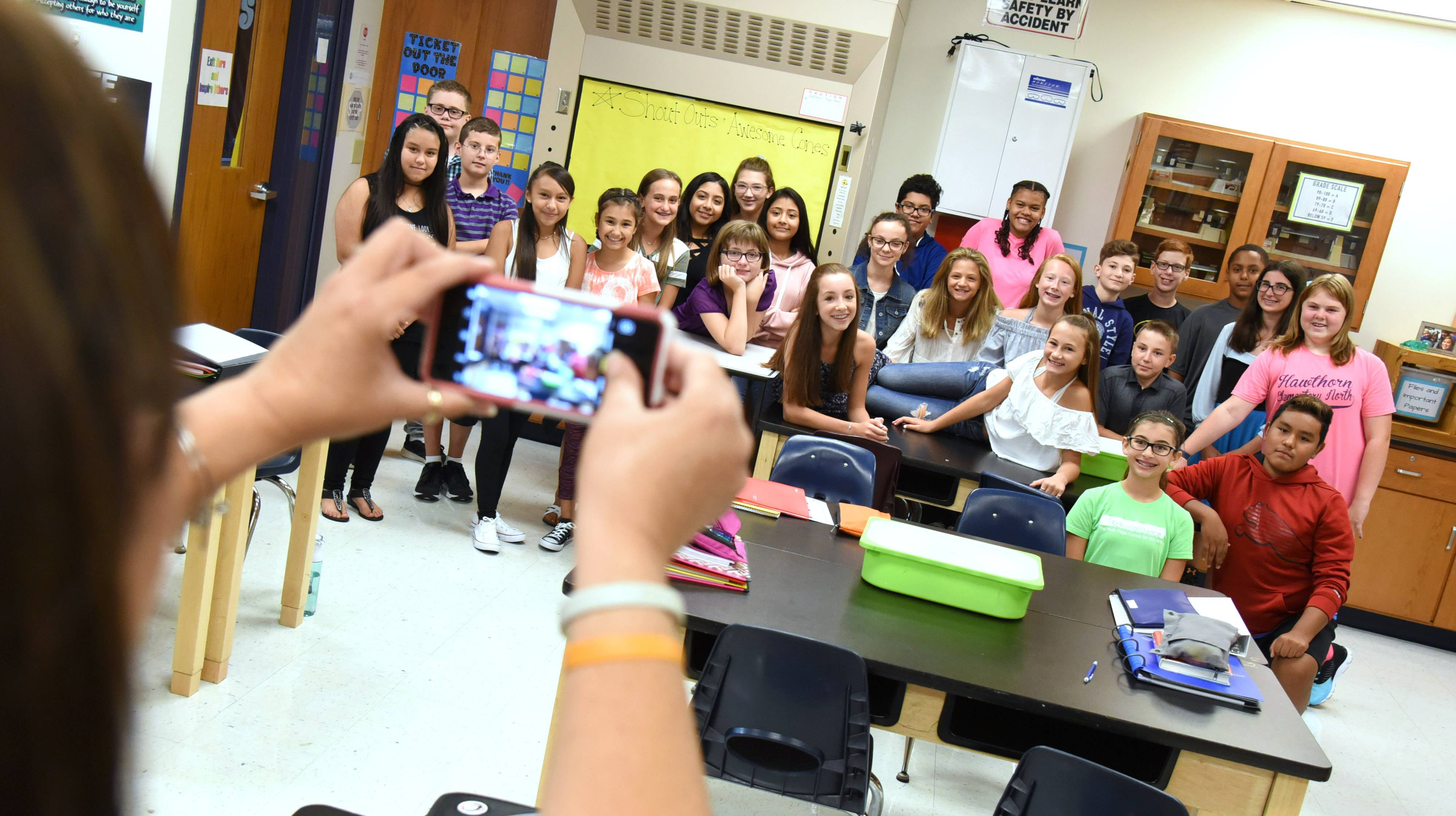 Hawthorn Middle School North teacher Cathi Neuman takes a group photo of one of the seventh-grade science classes she is teaching this year. Hawthorn District 73 held its first day of classes on Wednesday.