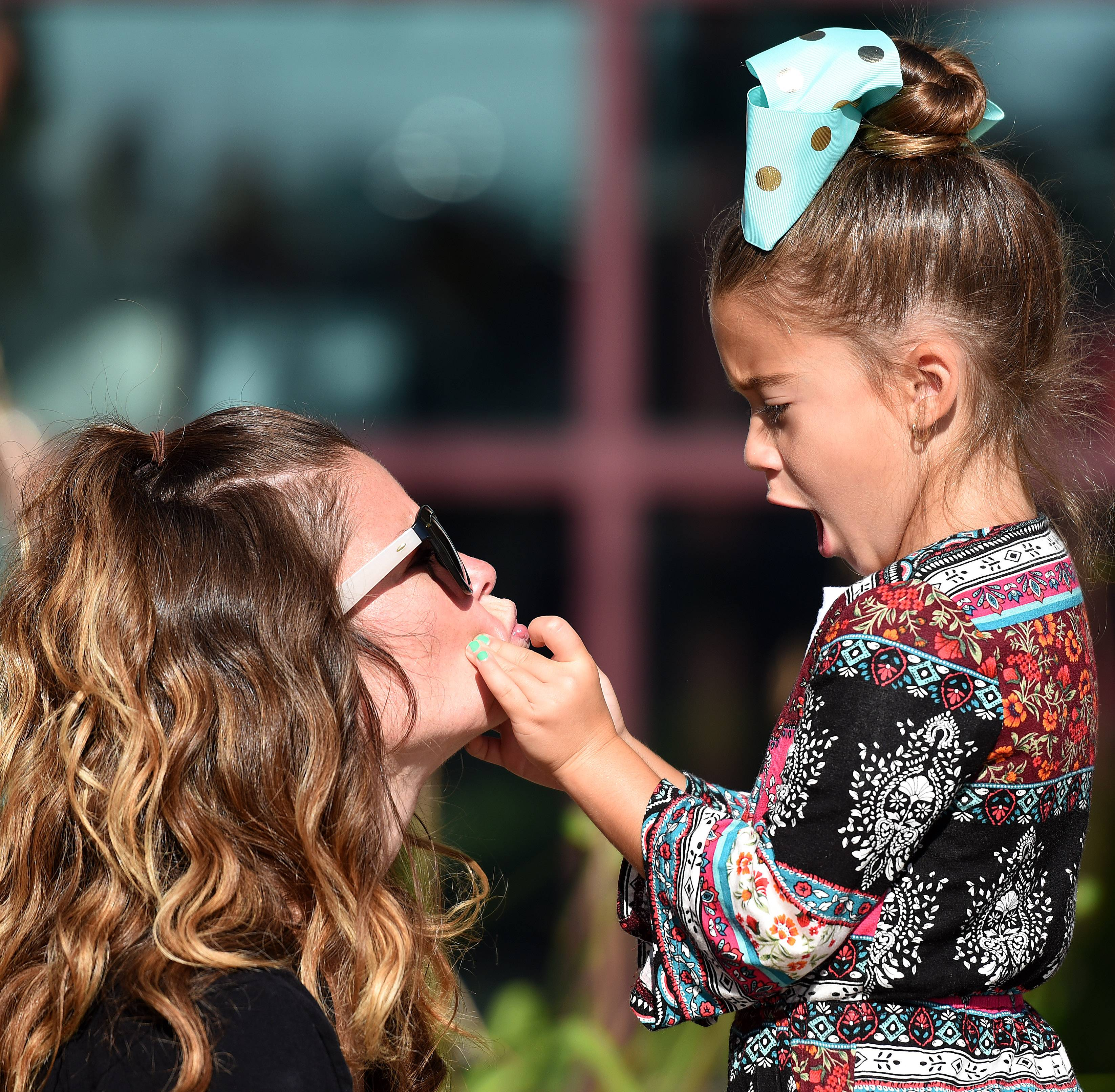 Aviana Digristina puckers up her mom Cherise's lips for a kiss before heading inside for the first day of kindergarten Wednesday at Prairie View Grade School in Elgin.