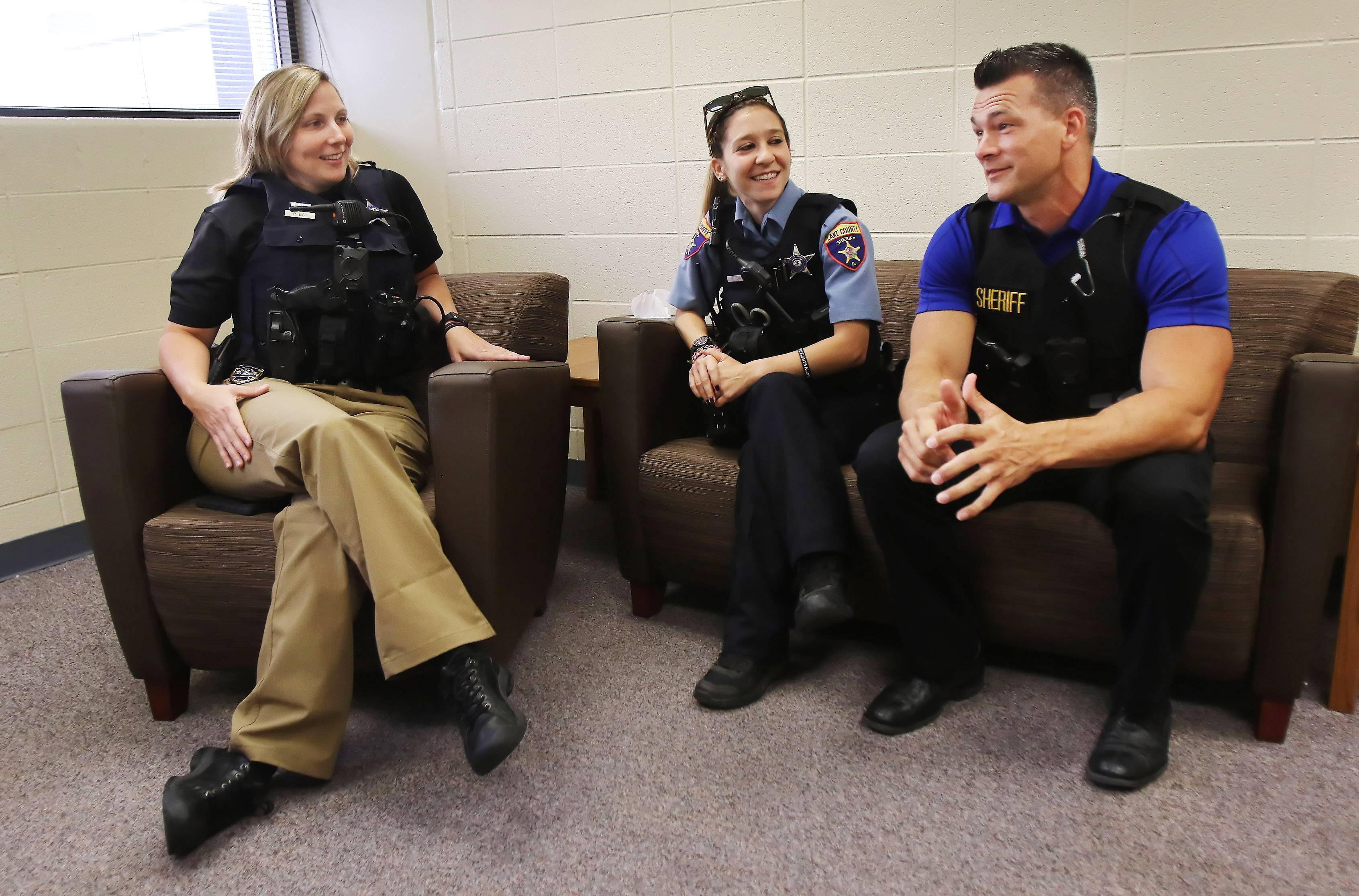 "Lake County sheriff's Detective Eric Carstensen, right, Deputy Rebecca Loeb, center, and Detective Trish List discuss appearing on the A&E Network show ""Live PD."" ""Once we got to know the camera crew and became used to them being around, it was a good time,"" Loeb says."
