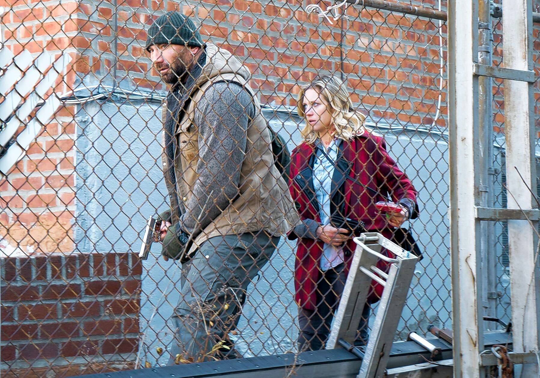 "A former U.S. Marine and now a janitor (Dave Bautista) and a college grad student (Brittany Snow) navigate the mean streets of Brooklyn during a massive military invasion in ""Bushwick."""