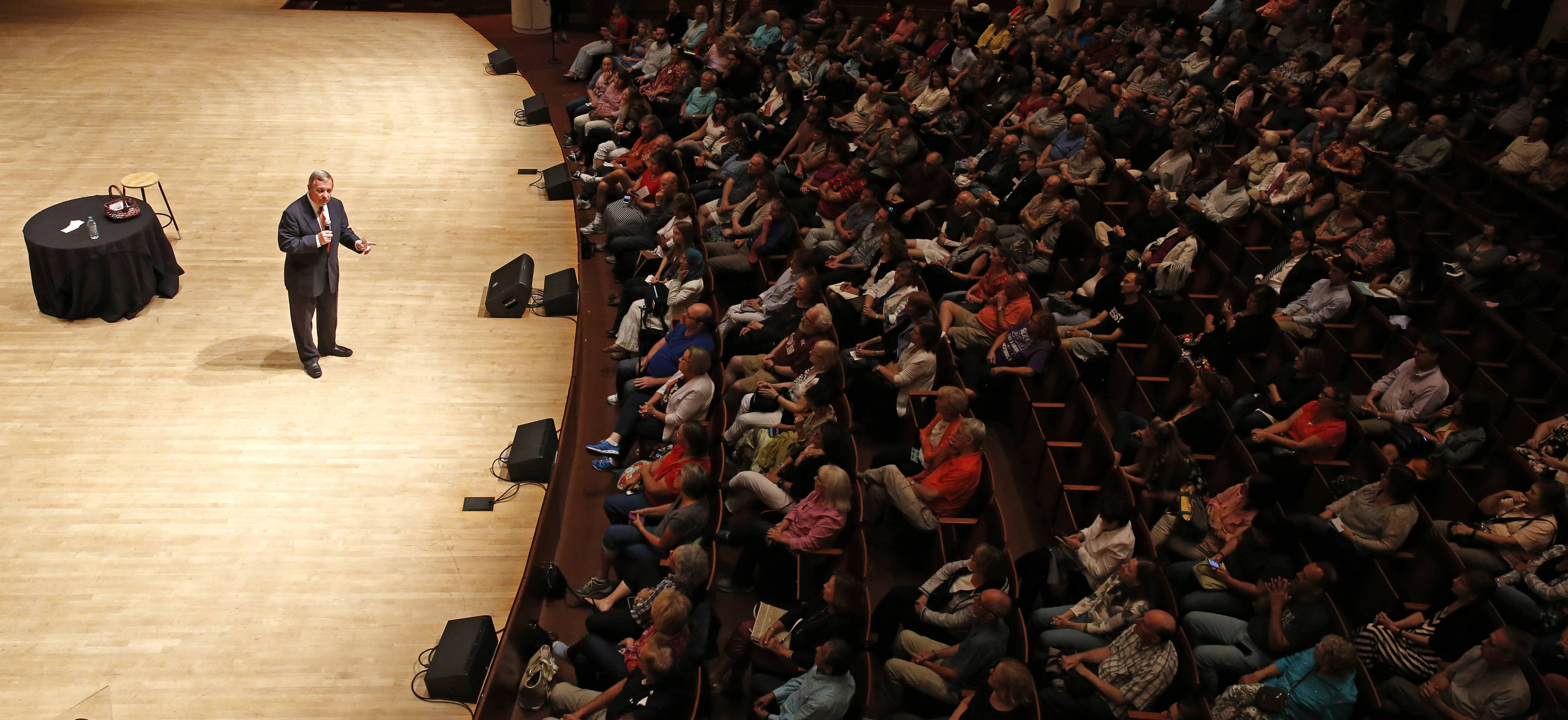 U.S. Sen. Dick Durbin speaks to about 350 supporters Thursday during a town hall discussion at Wentz Concert Hall in Naperville.