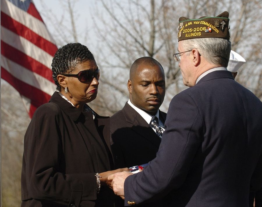 During a Veterans Day ceremony in Warrenville in 2005, a folded flag was presented to Sandra Williams Smith, whose son was killed that year in Iraq.