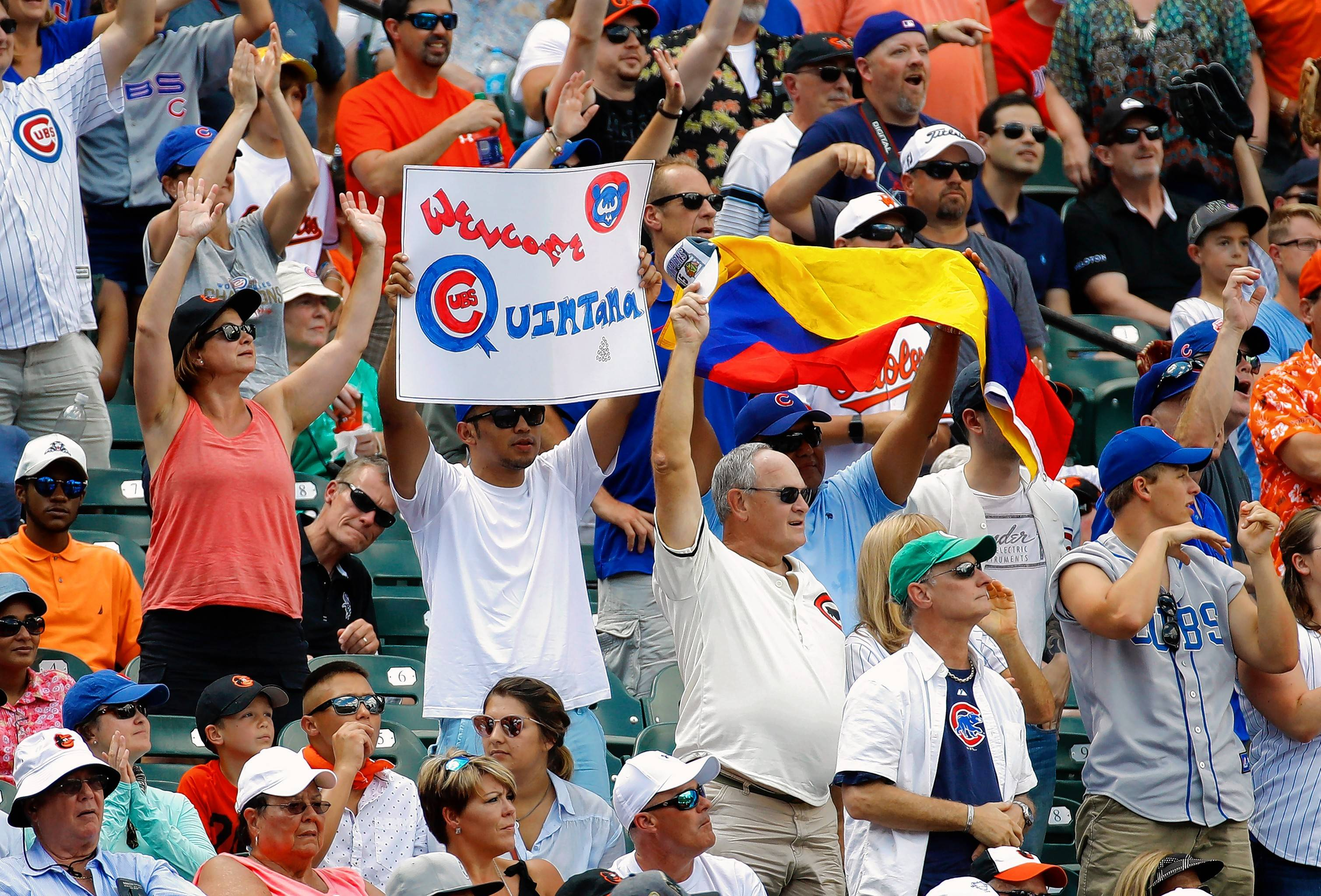 So many Chicago Cubs fans show up at opponents' ballparks that it often seems as if every Cubs game is a home game. A fan holds a sign for new Cubs' starting pitcher Jose Quintana during this July game against the Baltimore Orioles in Baltimore.