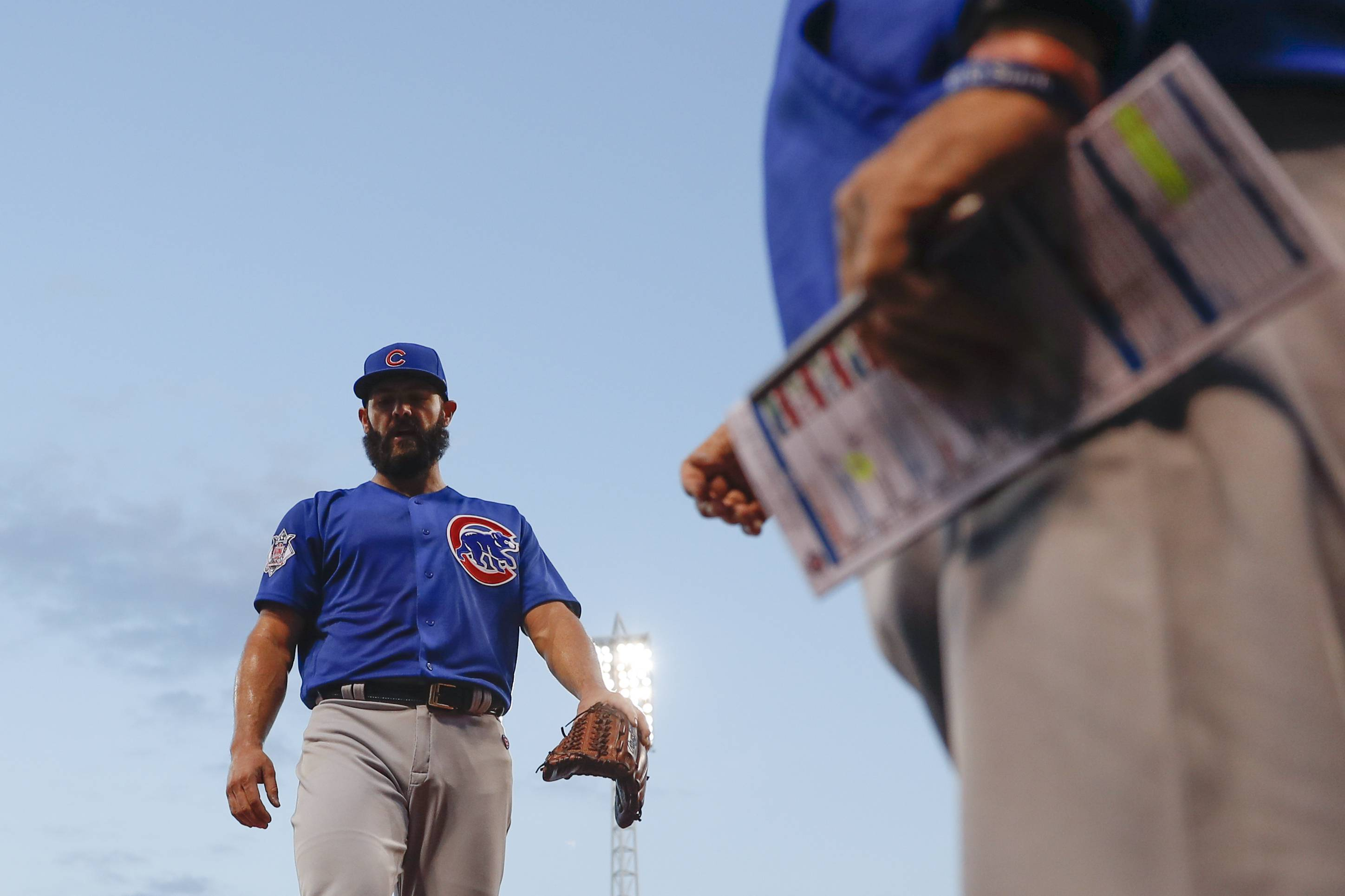 Chicago Cubs starting pitcher Jake Arrieta walks back to the dugout after the fourth inning of the team's baseball game against the Cincinnati Reds, Thursday, Aug. 24, 2017, in Cincinnati.
