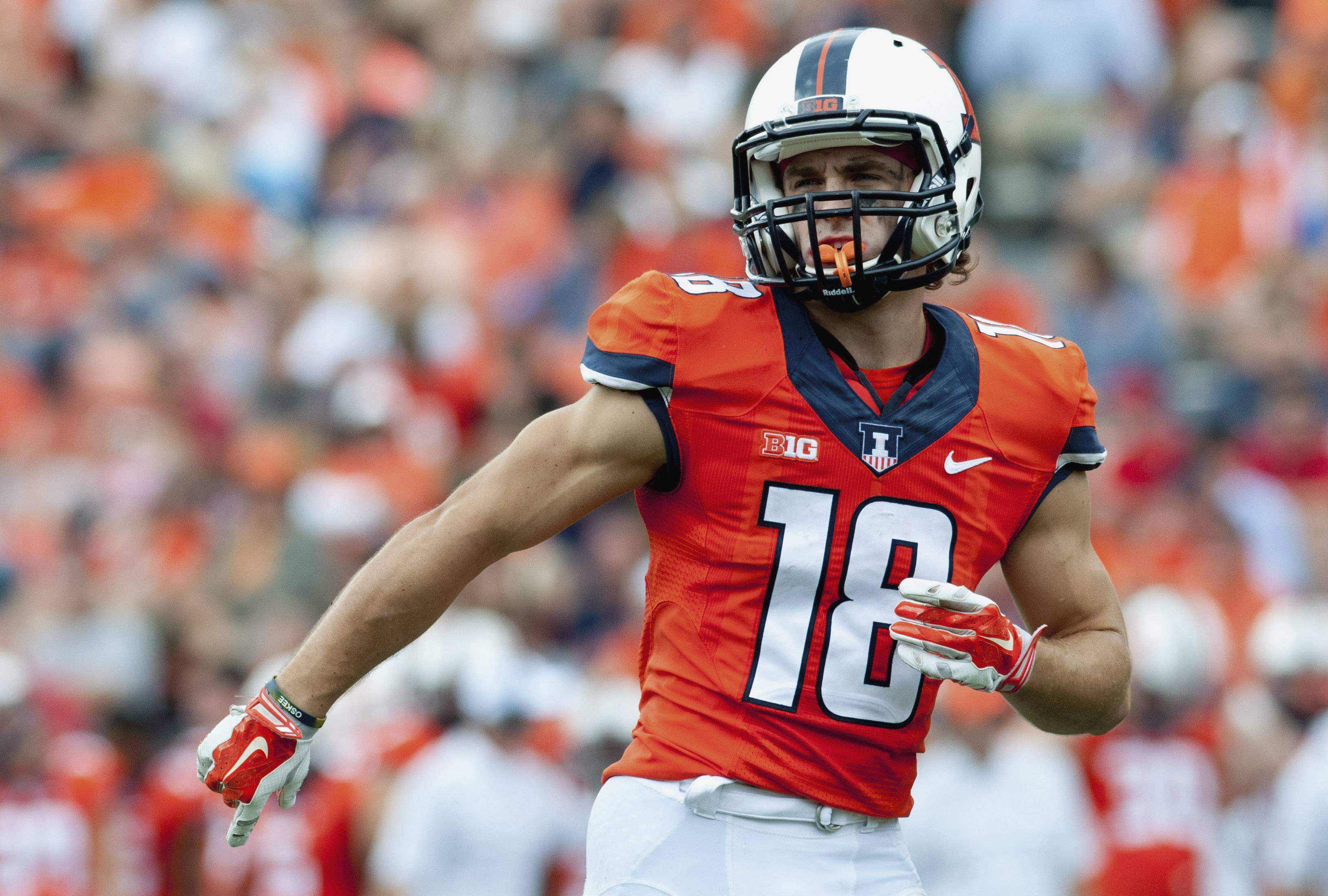 In this Sept. 6, 2014, file photo, Illinois wide receiver Mike Dudek takes his position before a snap during an NCAA college football game against Western Kentucky in Champaign, Ill.